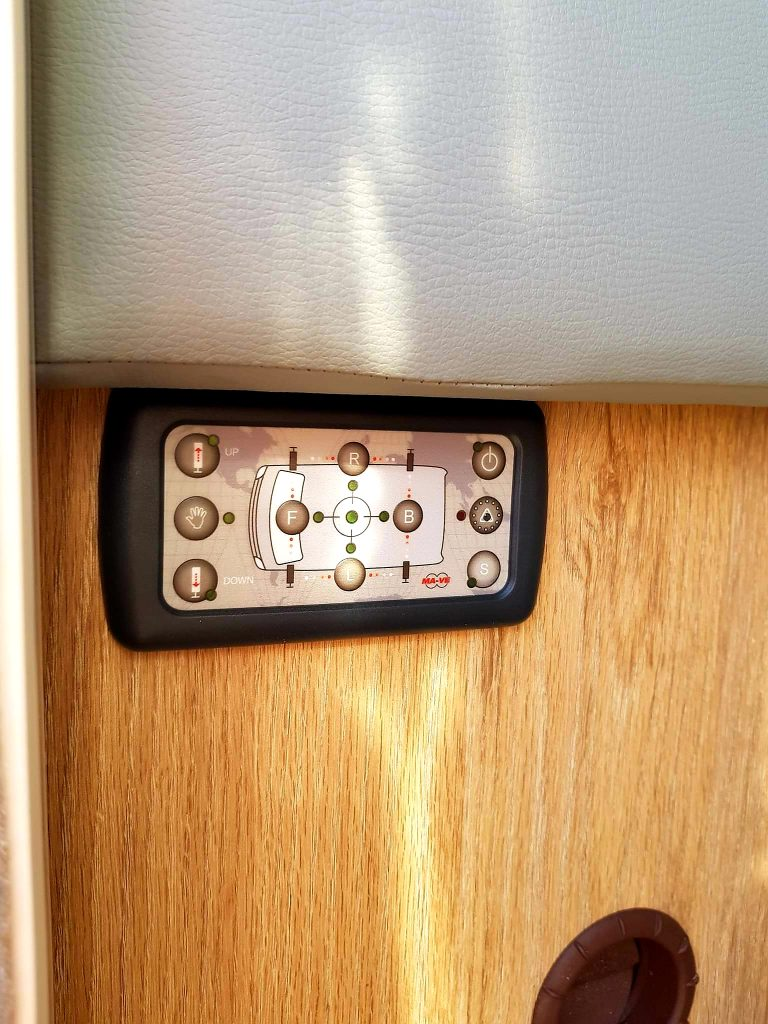 Motorhome levelling system in action with control panel